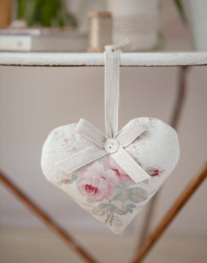 Peony and Sage -  French Florals Fabric Collection - A padded heart made from pale pink, green and white floral fabric, finished with a white button and a ribbon bow