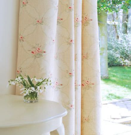 Peony and Sage -  French Florals Fabric Collection - Small white flowers in a glass on a bright white table, beside cream, pale pink and grey floral and patterned curtains
