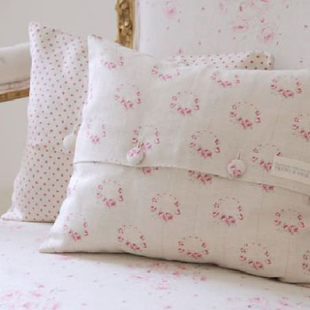 Peony and Sage -  French Florals Fabric Collection - An armchair made with a subtle floral pattern and a luxurious gold frame, withtwo pink and white dotted and floral cushions