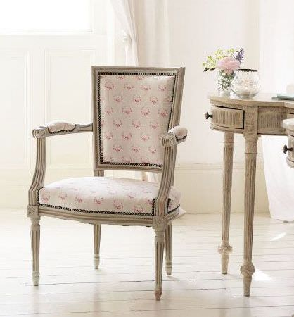 Peony and Sage -  French Florals Fabric Collection - A light brown desk style side table with a matching armchair made with a pink and off-white floral patterned seat and back