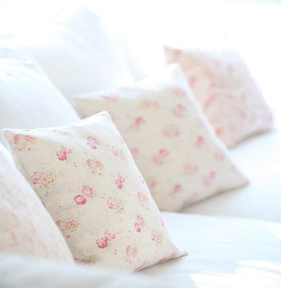 Peony and Sage -  French Florals Fabric Collection - Bedding and cushions, all in bright white, placed with square scatter cushions covered with florals in light pink shades