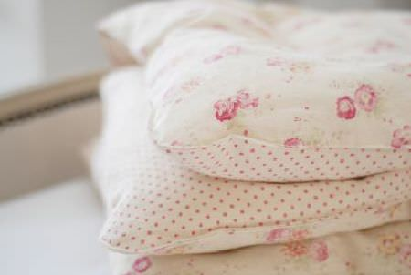 Peony and Sage -  French Florals Fabric Collection - A stack of double sided cushions made in cream and light pink shades, featuring small polka dot and floral patterns