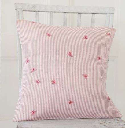 Peony and Sage -  French Florals Fabric Collection - A red and white square scatter cushion printed with thin stripes and bee designs, sitting on a simple white wood chair