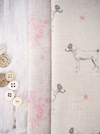 Peony and Sage -  Jack and Jill Fabric Collection - White painted wood with a scattering of buttons, pink and beige floral fabric, and beige fabric with pink stars and grey dogs
