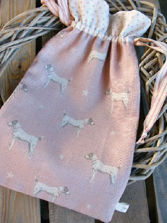 Peony and Sage -  Jack and Jill Fabric Collection - Wicker heart with a drawstring bag made fromtwo different light pink and white fabrics patterned with dogs and tiny stars