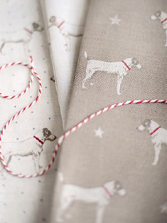 Peony and Sage -  Jack and Jill Fabric Collection - Folds of two different grey, red and white dot, star and dog patterned fabrics, with some red and white twine