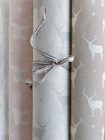 Peony and Sage -  Jack and Jill Fabric Collection - Rolls of four stag and star patterned fabrics, in pale pink, white and shades of grey, with grey ribbon tied around one