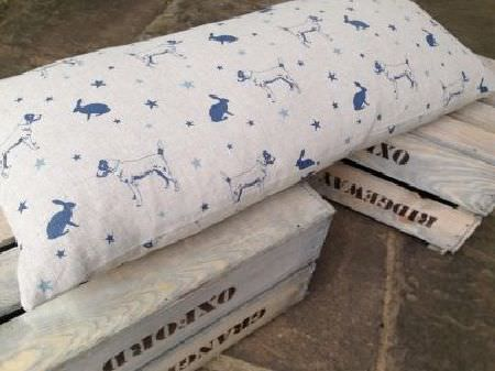 Peony and Sage -  Jack and Jill Fabric Collection - Wooden crates topped with a long rectangular cushion made from light grey fabric featuring navy blue stars, dogs and hares