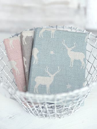 Peony and Sage -  Jack and Jill Fabric Collection - White woven basket holding pink and white, grey and white, and blue and white stag and star print fabrics