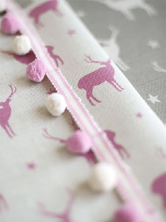 Peony and Sage -  Jack and Jill Fabric Collection - Dark pink stars and stags printed on white fabric with pink and white pompom edging, with matching grey and white fabric