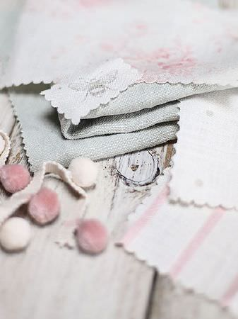 Peony and Sage -  Plain Linens Fabric Collection - Pink and white pompoms and ribbon with swatches of fabric in plain grey, pink and white florals, dots, stripes and bee prints