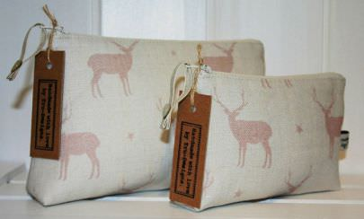 Peony and Sage -  Skandi Range Fabric Collection - Brown tags tied to two small bags made from fabric in off-white and light blush pink, featuring stag and star prints