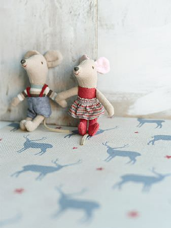 Peony and Sage -  Skandi Range Fabric Collection - Two small stuffed toy mice sitting on fabric featuring a pattern of stags and stars in off-white, blood red and denim blue