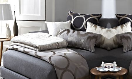 Prestigious Textiles -  Atmosphere Fabric Collection - Modern style bed with patterned throws, bedspreads and cushions in various geometric patterns