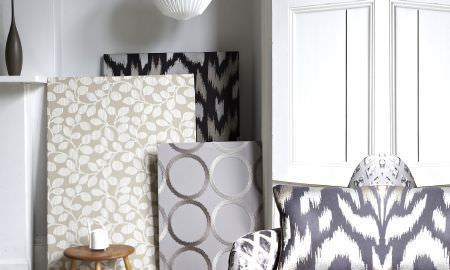 Prestigious Textiles -  Atmosphere Fabric Collection - Mood boards and cushions in grey, tan, white and cream showing checked, circular and animal print patterns