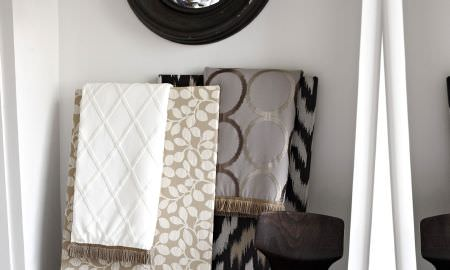 Prestigious Textiles -  Atmosphere Fabric Collection - various fabric mood boards showing tan and white leaf patterm, grey and brown circular pattern and white checked fabrics