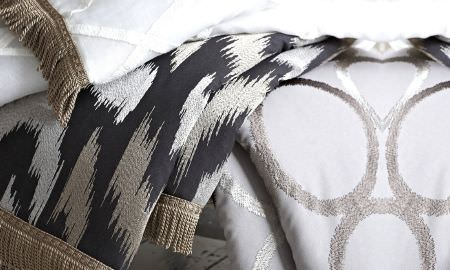 Prestigious Textiles -  Atmosphere Fabric Collection - Tasselled quilt and throw samples in checked, circle and abstract patterns