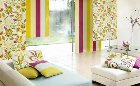 Prestigious Textiles -  Babushka Fabric Collection - Modern colourful curtains in white, yellow and pink with abstract flower prints and monochrome upholstered seating