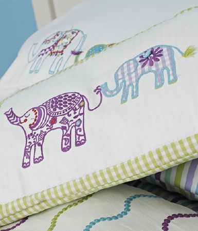 Prestigious Textiles -  Be Happy Fabric Collection - A selection of fabrics featuring cream, light purple, blue and green elephant prints,checks, dotted wavy lines and striped patterns