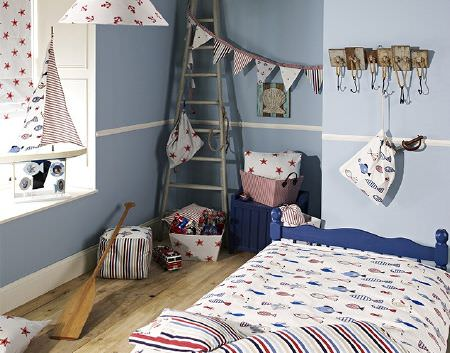 Prestigious Textiles -  Be Happy Fabric Collection - Striped, star, fish and anchor print fabrics in white, reds and blues, made into bedding, a footstool, cushions, a lampshade, blind and bag