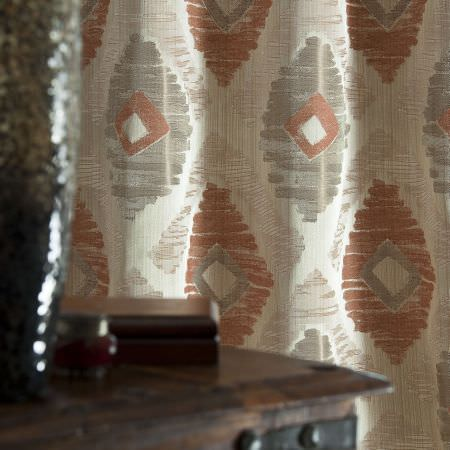Prestigious Textiles -  Berber Fabric Collection - Diamond and oval patterned curtains in colours of orange, brown and yellow