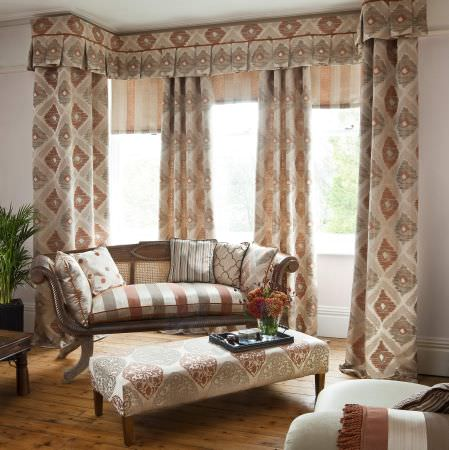 Prestigious Textiles -  Berber Fabric Collection - Elegant room in cream, terracotta and green with striped sofa, diamond pattern curtains and pelmet, and matching cushions