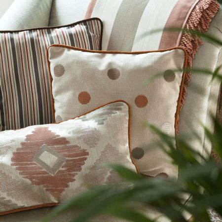Prestigious Textiles -  Berber Fabric Collection - Ribbed and tasselled square and rectangular cushions in cream, green and terracotta, with striped, spotted and diamond patterning