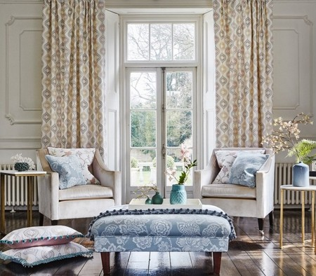 Prestigious Textiles -  Bloom Fabric Collection - White and duck egg blue cushions with classic flower images and a white curtain with a flower grid giving a nice country atmosphere