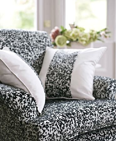 Prestigious Textiles -  Boutique Fabric Collection - Black andwhite speckled armchair with 2 cushions featuring a matching strip running down the centre of white backgrounds