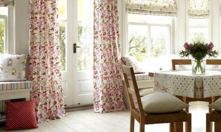 Prestigious Textiles -  Butterfly Gardens Fabric Collection - Light room with cottage feel displaying striped, spotted and floral patterned cushions, tablecloth, curtain and blind fabrics