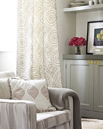 Prestigious Textiles -  Canvas Fabric Collection - Grey and white circle print curtains with a grey and white striped armchair, matching patterned cushions and a grey throw