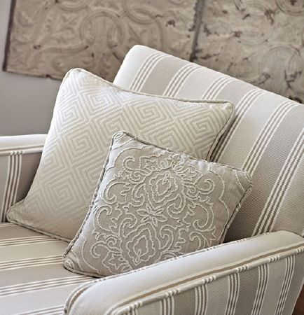 Prestigious Textiles -  Canvas Fabric Collection - A striped armchair with two square patterned scatter cushions, all made in light shades of grey, cream and white