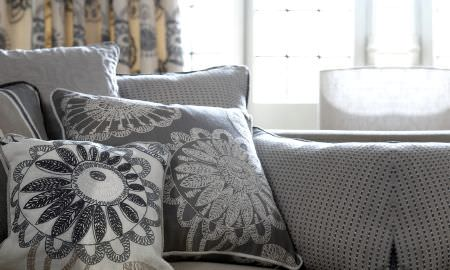 Prestigious Textiles -  Clover Fabric Collection - Modern embroidered cushions in cream and grey, abstract and spot patterns