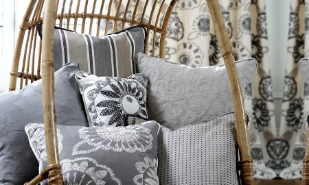 Prestigious Textiles -  Clover Fabric Collection - Selection of striped, spotted and embroidered cushions in grey, cream and tan