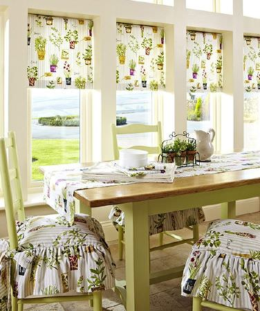 Prestigious Textiles -  Country Fair Fabric Collection - Potted plant print fabric window blinds, table runner, frilly tie-on chair cushions, with a pale green wood table and matching chairs