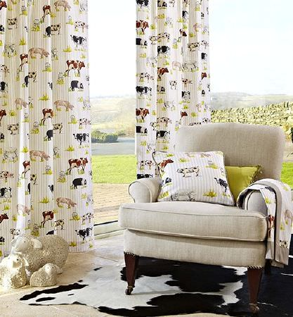 Prestigious Textiles -  Country Fair Fabric Collection - Plain beige padded armchair with fabric, curtains and a cushion in a striped farm animal print, with a lime green cushion and a cowskin rug