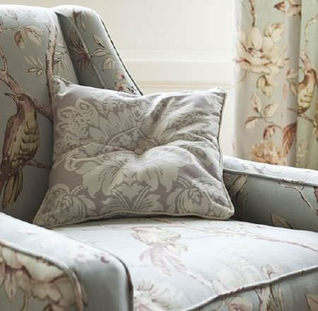 Prestigious Textiles -  Country House Fabric Collection - Bird and floral design padded armchair and curtains, with grey and cream patterned cushion