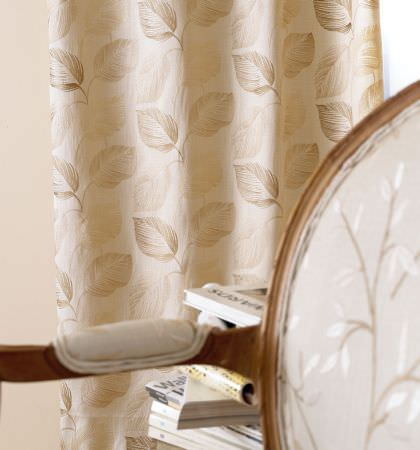 Prestigious Textiles -  Countryside Fabric Collection - Close-up shot of gold curtain with detailed leaf stitching for a classic atmosphere