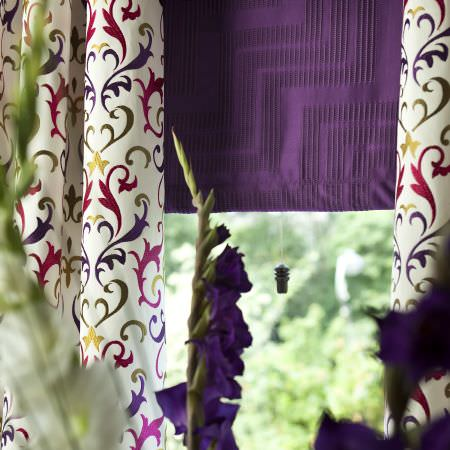 Prestigious Textiles -  Couture Fabric Collection - White curtain with classic Post-Medieval design in various colours and a purple roman blind with zigzag lines