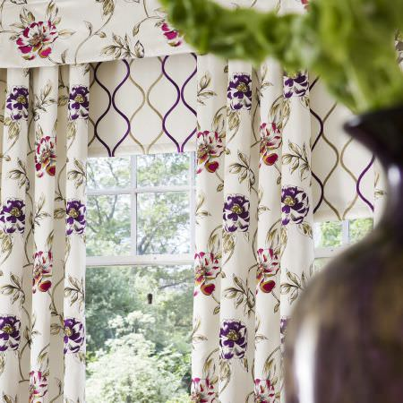 Prestigious Textiles -  Couture Fabric Collection - Classic white curtain valance with detailed prints of purple and red flowers, and modern roman blinds with wavy lines