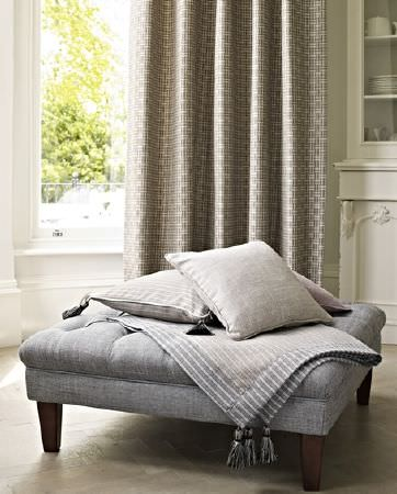 Prestigious Textiles -  Dalesway Fabric Collection - Upholstered square ottoman in grey covered with plain light grey cushion and grey cushion featuring white stripes
