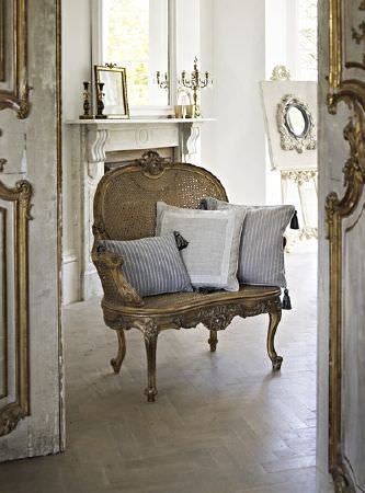 Prestigious Textiles -  Dalesway Fabric Collection - Elegant vintage armchair with three decorative grey cushions featuring different decorative designs