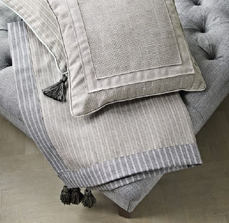 Prestigious Textiles -  Dalesway Fabric Collection - Upholstered light grey ottoman with buttons, light grey furniture cover with white stripes and modern cushions