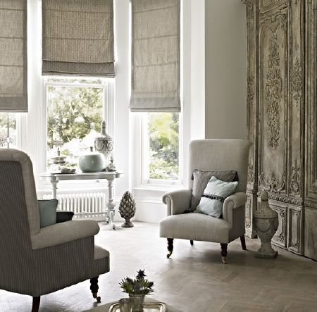 Prestigious Textiles -  Dalesway Fabric Collection - Matching furniture set featuring upholstered beige armchairs, beige roman blinds and light blue cushions