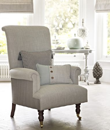 Prestigious Textiles -  Dalesway Fabric Collection - Upholstered grey armchair with slightly darker back and two decorative cushions in different shades of grey