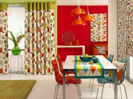 Prestigious Textiles -  Delamere Fabric Collection - A modern narrow tablecloth in lively colours, a white and green curtain with an autumn leaf design, and a curtain with a leaf grid
