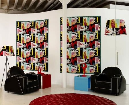 Prestigious Textiles -  Diva Fabric Collection - Round, shiny, quilted red rug with black armchairs, red and blue plastic tables, and multicoloured, patterned lamp shades and wall hangings