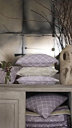 Prestigious Textiles -  Dorchester Fabric Collection - Pale grey, green and cream shades on checked, striped and floral patterns on fabric and cushions, in a distressed grey cabinet