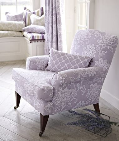 Prestigious Textiles -  Dorchester Fabric Collection - An embroidered floral pale lilac and white armchair, with a co-ordinating cushion and curtains, and striped scatter cushions