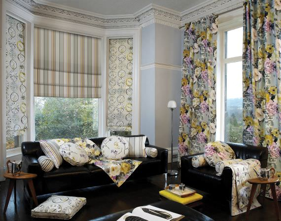 Prestigious Textiles -  Drawing Room Fabric Collection - Modern meets formal sitting room - Roman blinds, curtains, throws and cushions - clock, floral and striped designs
